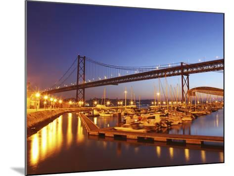 Boats on the River Tagus Move at Night in the Doca De Santa Amaro Marina under the 25 April Bridge,-Stuart Forster-Mounted Photographic Print