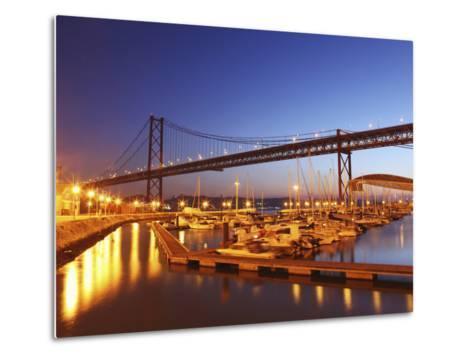 Boats on the River Tagus Move at Night in the Doca De Santa Amaro Marina under the 25 April Bridge,-Stuart Forster-Metal Print