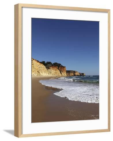 A Wave Breaks on Golden Sands Flanked by Steep Cliffs, Typical of the Atlantic Coastline Near Lagos-Stuart Forster-Framed Art Print