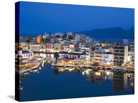 View over Harbour and Restaurants at Dusk, Ayios Nikolaos, Lasithi Region, Crete, Greek Islands, Gr-Stuart Black-Stretched Canvas Print