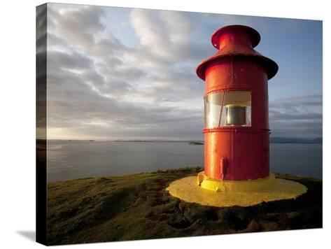 Lighthouse on Bluff Above Stykkisholmer, Iceland-Dave Bartruff-Stretched Canvas Print