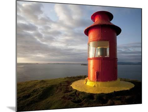 Lighthouse on Bluff Above Stykkisholmer, Iceland-Dave Bartruff-Mounted Photographic Print