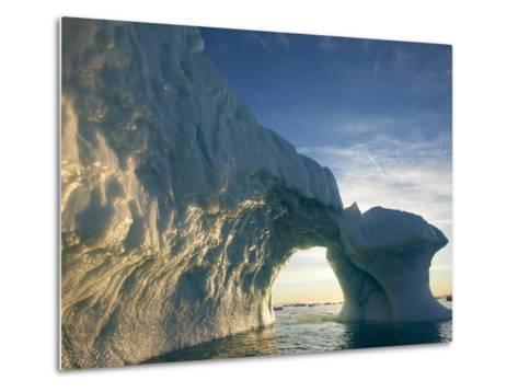 Midnight Sun Lights Arched Iceberg Floating Near Face of Jakobshavn Isfjord, Ilulissat, Greenland-Paul Souders-Metal Print