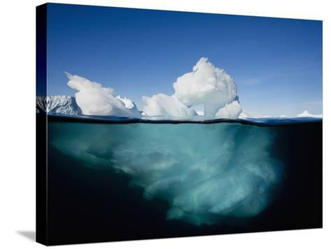 Underwater Image of Icebergs Floating Near Face of Jakobshavn Isfjord, Ilulissat, Greenland-Paul Souders-Stretched Canvas Print