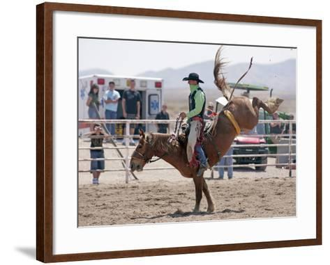 Competitor in the Bronco Riding Event During the Annual Rodeo Held in Socorro, New Mexico, Usa-Luc Novovitch-Framed Art Print