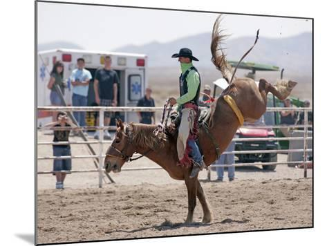 Competitor in the Bronco Riding Event During the Annual Rodeo Held in Socorro, New Mexico, Usa-Luc Novovitch-Mounted Photographic Print