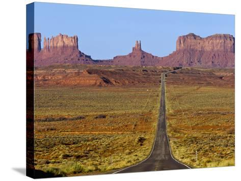 Highway 163 Leads to Monument Valley Navajo Tribal Park on the Arizona and Utah State Line, Usa-Chuck Haney-Stretched Canvas Print