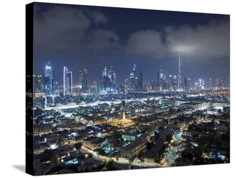 United Arab Emirates, Dubai, Skyline of Modern Skyscrapers Including the Burj Khalifa on Sheikh Zay-Gavin Hellier-Stretched Canvas Print