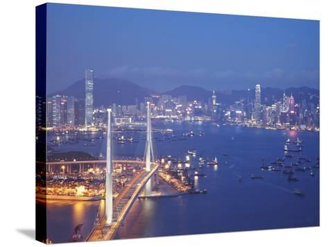 Stonecutters Bridge, Victoria Harbour and Hong Kong Island at Dusk, Hong Kong, China-Ian Trower-Stretched Canvas Print