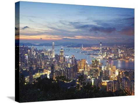 Hong Kong Island and Kowloon Skylines at Sunset, Hong Kong, China-Ian Trower-Stretched Canvas Print
