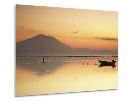 Fisherman Standing in Sea with Mount Agung in the Background, Sanur, Bali, Indonesia-Ian Trower-Metal Print