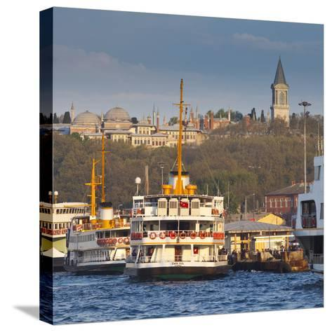 Topkapi Palace and Ferries on the Waterfront of the Golden Horn, Istanbul, Turkeyistanbul, Turkey-Jon Arnold-Stretched Canvas Print