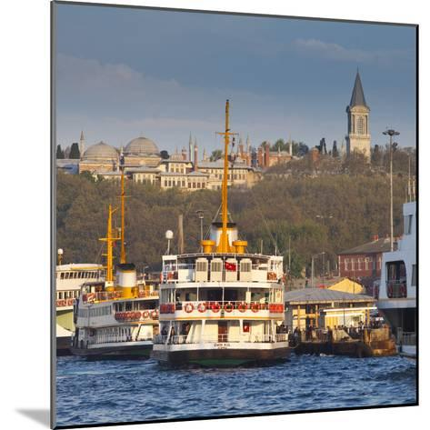 Topkapi Palace and Ferries on the Waterfront of the Golden Horn, Istanbul, Turkeyistanbul, Turkey-Jon Arnold-Mounted Photographic Print