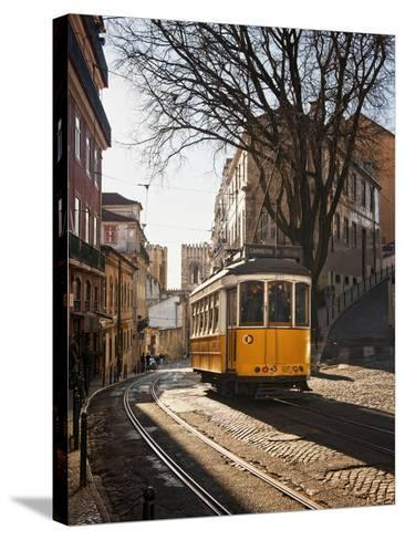 A Tramway in Alfama District, Lisbon-Mauricio Abreu-Stretched Canvas Print
