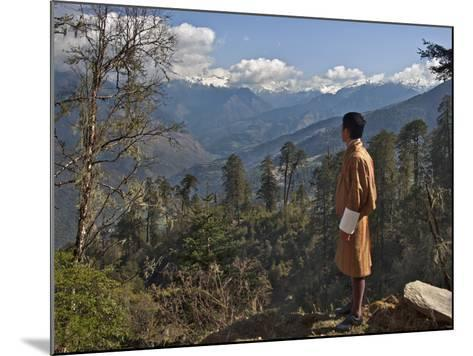 A Bhutanese Man in National Costume Views an Eastern Himalayan Mountain Range from the 11,000-Foot--Nigel Pavitt-Mounted Photographic Print