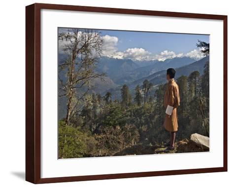 A Bhutanese Man in National Costume Views an Eastern Himalayan Mountain Range from the 11,000-Foot--Nigel Pavitt-Framed Art Print