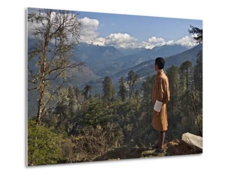 A Bhutanese Man in National Costume Views an Eastern Himalayan Mountain Range from the 11,000-Foot--Nigel Pavitt-Metal Print