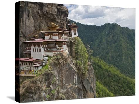 Taktshang Goemba, 'Tiger's Nest', Bhutan's Most Famous Monastery, Perched Miraculously on Ledge of -Nigel Pavitt-Stretched Canvas Print