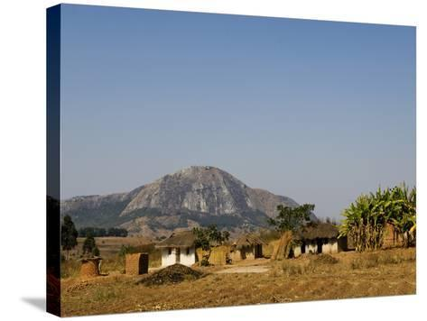 Malawi, Dedza, Grass-Roofed Houses in a Rural Village in the Dedza Region-John Warburton-lee-Stretched Canvas Print