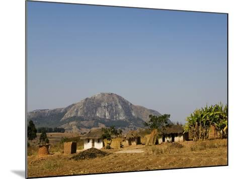 Malawi, Dedza, Grass-Roofed Houses in a Rural Village in the Dedza Region-John Warburton-lee-Mounted Photographic Print