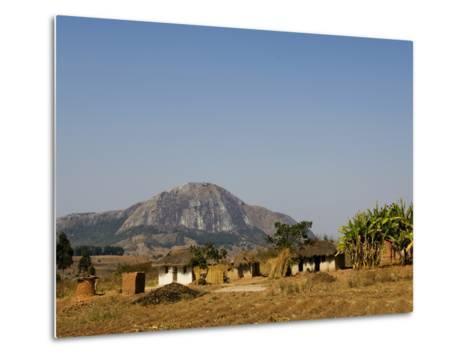 Malawi, Dedza, Grass-Roofed Houses in a Rural Village in the Dedza Region-John Warburton-lee-Metal Print