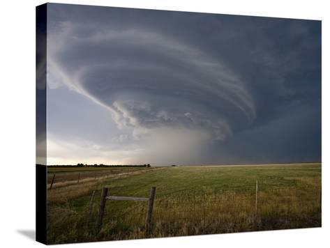 Rotating Wall Cloud from a Supercell in Eastern Colorado-Charles Doswell-Stretched Canvas Print