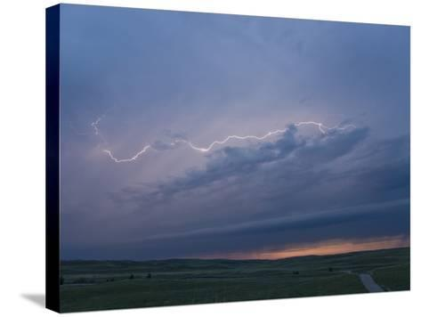 Intracloud Lightning at Sunset from a Thunderstorm in Central Nebraska, USA-Charles Doswell-Stretched Canvas Print