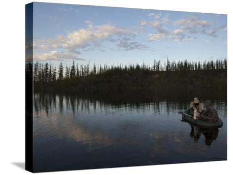Two Undergraduate Students Use a Van Dorn Sampler to Collect Water Samples-Chris Linder-Stretched Canvas Print