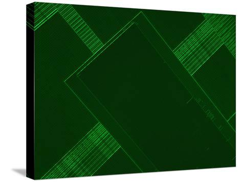 Micrograph of a Computer Microprocessor, LM X200, Epifluorecence, UV Illumination-Robert Markus-Stretched Canvas Print