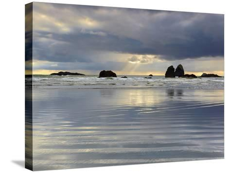 Sunbeams on Cloudy, Stormy Day Behind the Sandy Beach and Offshore Rocks-Patrick Smith-Stretched Canvas Print