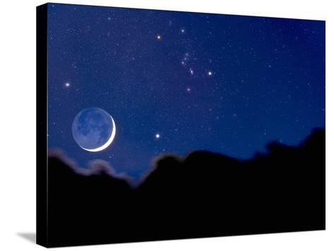 Crescent Moon with Earthshine Above a Cloud Layer with the Constellation Orion-David Nunuk-Stretched Canvas Print