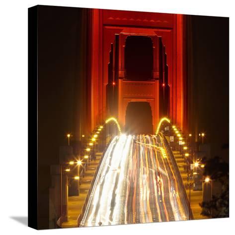 Nightime Traffic on the Golden Gate Bridge, San Francisco, California, USA-Patrick Smith-Stretched Canvas Print
