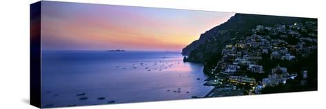 Buildings Lit Up at Night, Positano, Amalfi, Amalfi Coast, Campania, Italy--Stretched Canvas Print