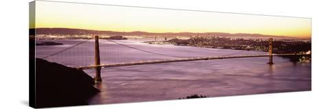 Suspension Bridge Lit Up at Dusk, Golden Gate Bridge, San Francisco Bay, San Francisco, Californ...--Stretched Canvas Print