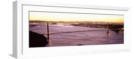 Suspension Bridge Lit Up at Dusk, Golden Gate Bridge, San Francisco Bay, San Francisco, Californ...--Framed Art Print