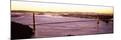Suspension Bridge Lit Up at Dusk, Golden Gate Bridge, San Francisco Bay, San Francisco, Californ...--Mounted Photographic Print