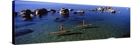 Two Women Paddle Boarding in a Lake, Lake Tahoe, California, USA--Stretched Canvas Print