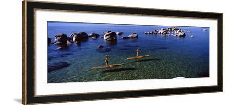 Two Women Paddle Boarding in a Lake, Lake Tahoe, California, USA--Framed Art Print