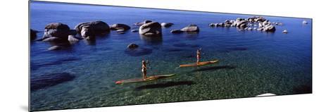 Two Women Paddle Boarding in a Lake, Lake Tahoe, California, USA--Mounted Photographic Print