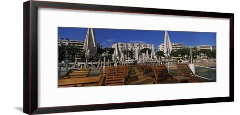Lounge Chairs and Beach Umbrellas on the Beach, Cannes, Alpes-Maritimes, Provence-Alpes-Cote D'A...--Framed Art Print