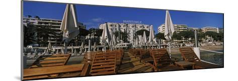 Lounge Chairs and Beach Umbrellas on the Beach, Cannes, Alpes-Maritimes, Provence-Alpes-Cote D'A...--Mounted Photographic Print