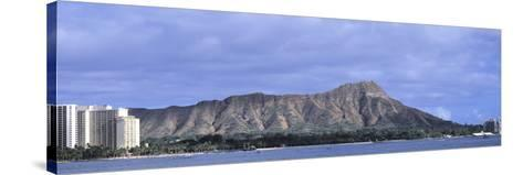 Buildings with Mountain Range in the Background, Diamond Head, Honolulu, Oahu, Hawaii, USA--Stretched Canvas Print