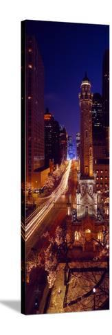 Buildings Lit Up at Night, Water Tower, Magnificent Mile, Michigan Avenue, Chicago, Cook County,...--Stretched Canvas Print