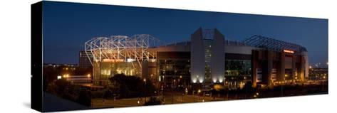 Football Stadium Lit Up at Night, Old Trafford, Greater Manchester, England--Stretched Canvas Print