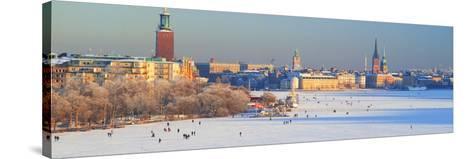 People Strolling across Frozen Riddarfjarden, Riddarholmen, Stockholm, Sweden--Stretched Canvas Print