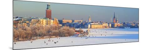 People Strolling across Frozen Riddarfjarden, Riddarholmen, Stockholm, Sweden--Mounted Photographic Print