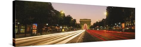 Traffic on the Road, Avenue Des Champs-Elysees, Arc De Triomphe, Paris, Ile-De-France, France--Stretched Canvas Print