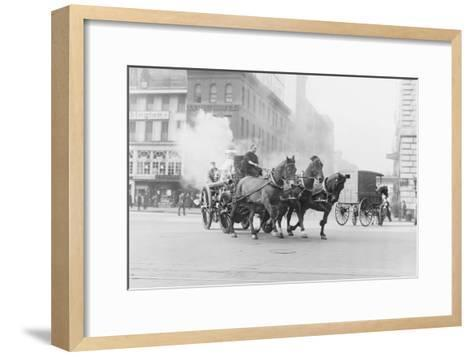 A Team of Horses Pulls a Steam Pumper across Paved Streets Toward a Fire Scene.--Framed Art Print