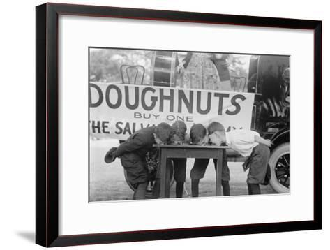 Boys Chow Down on a Table in a Donut Eating Contest--Framed Art Print