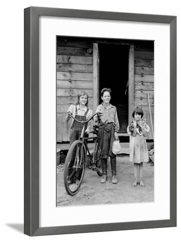 Beautiful Children with Bike and a Cat-Dorothea Lange-Framed Art Print